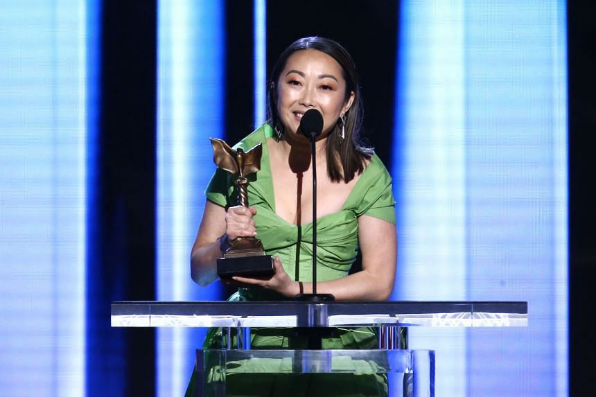 The Farewell director Lulu Wang accepting the best supporting actress award on behalf of winner Zhao Shuzhen during the 2020 Film Independent Spirit Awards.
