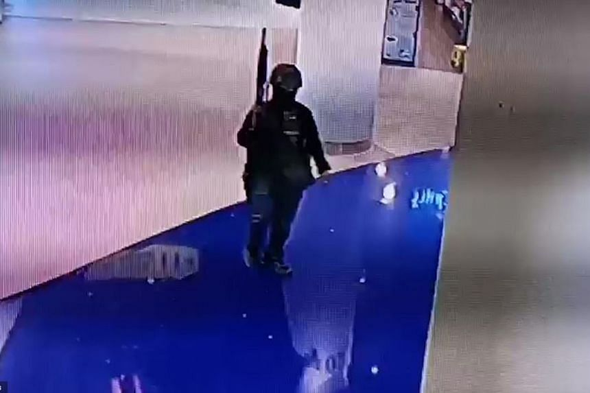 Closed-circuit video footage of the gunman at a mall during the shooting