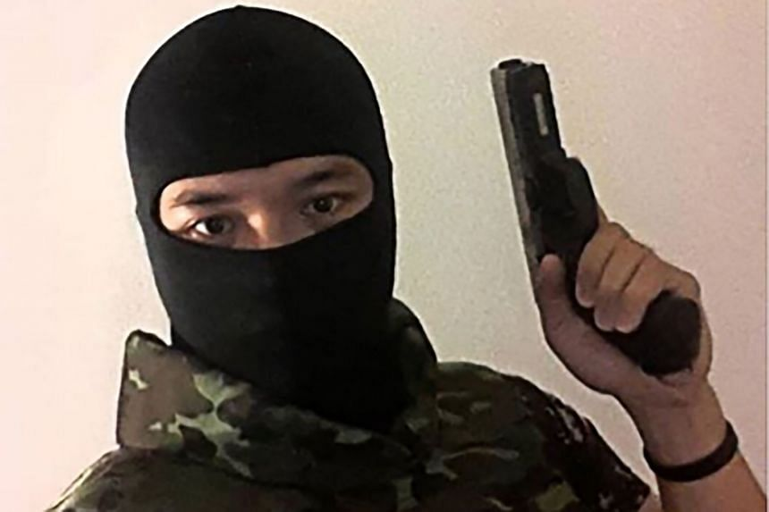 A screenshot from the Facebook page of Jakrapanth Thomma shows him holding a gun at an unknown location.