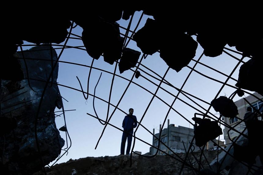 A Palestinian man inspects the site of an Israeli airstrike at Al-Shatee refugee camp in Gaza City Feb 6, 2020.