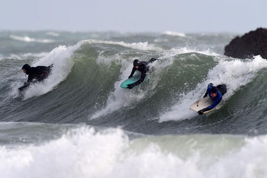 Body boarders riding the stormy waves at Broad Haven, Pembrokeshire, Wales, as Storm Ciara approaches the coastline, on Feb 8, 2020.