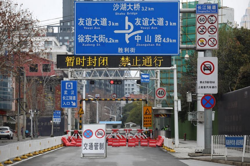 A road block is seen following the outbreak of the coronavirus in Wuhan, Hubei province, on Feb 7, 2020.