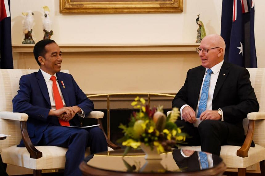 Australia's Governor-General David Hurley greeting Indonesian President Joko Widodo during a welcome ceremony at Government House in Canberra on Feb 9, 2020.