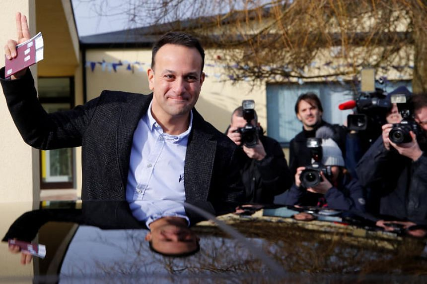 Irish Prime Minister Leo Varadkar waving to reporters after casting his vote in Dublin on Feb 8, 2020.