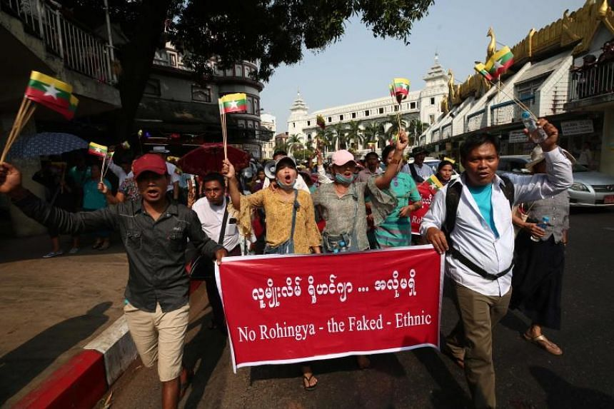 Demonstrators carrying a banner protesting against the Rohingya minority group, in Yangon, Myanmar, on Feb 9, 2020.