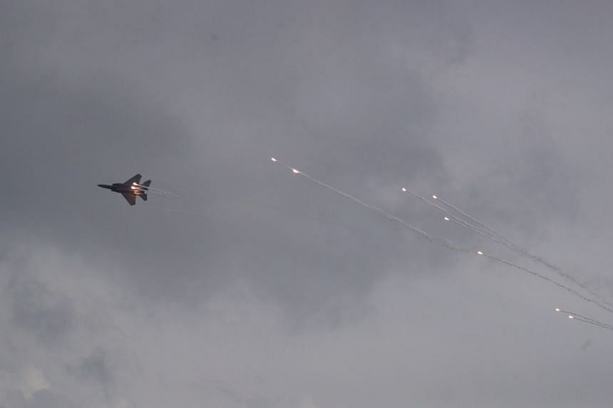 An RSAF F-15SG releasing flares during a preview at the Singapore Airshow on Feb 9, 2020.