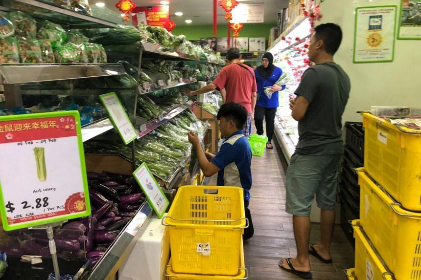 Staff at Sheng Siong Loyang Point restocking shelves on Feb 9, 2020.