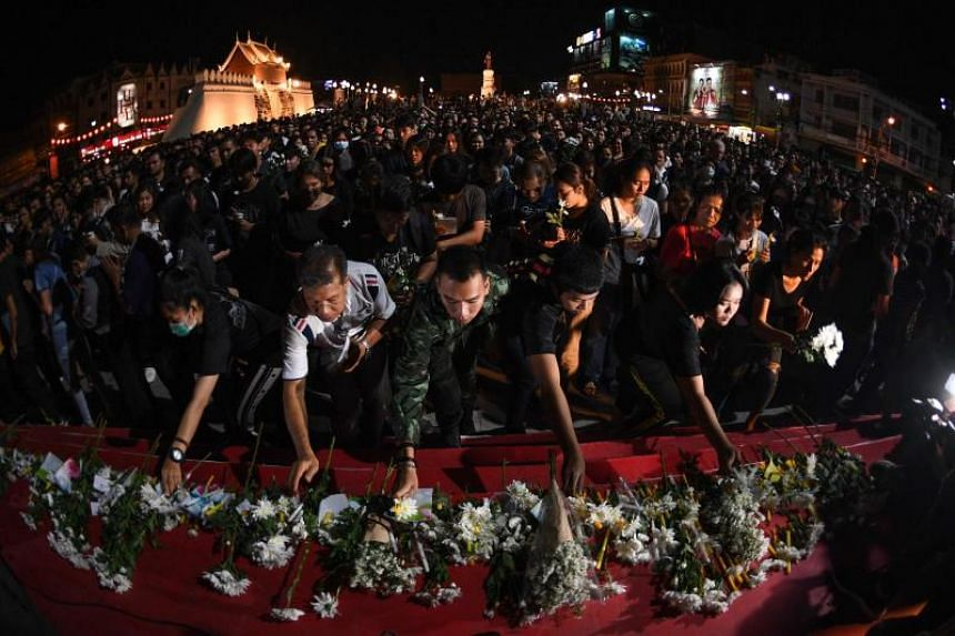 People laying flowers at a vigil for the victims of a mass shooting in Nakhon Ratchasima, on Feb 9, 2020.