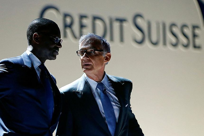 Credit Suisse Group chairman Urs Rohner (at right) and former chief executive Tidjane Thiam in a 2017 file photo.