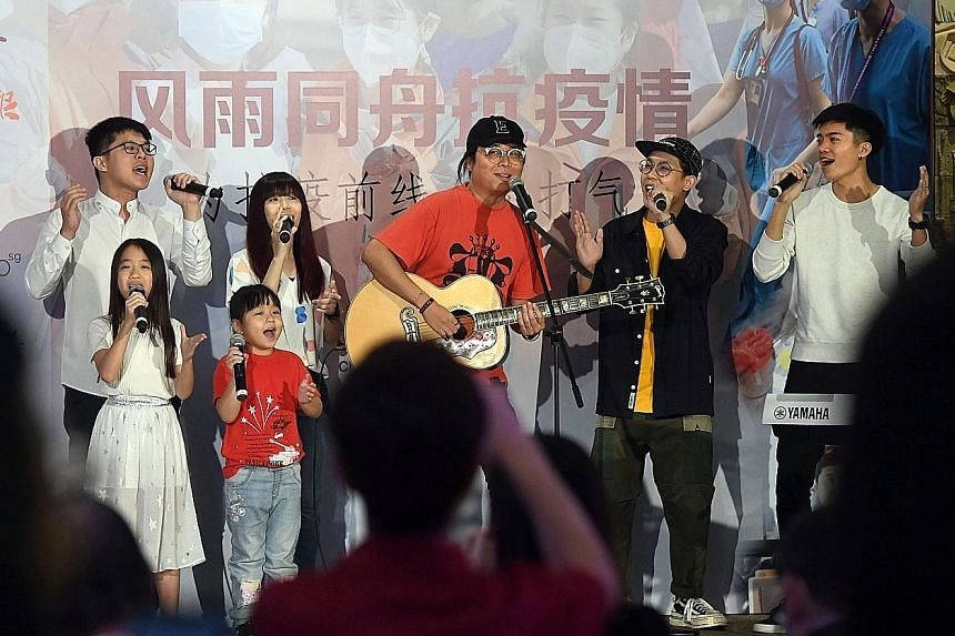 Award-winning songwriter and music producer Eric Ng (with guitar), singing last night with six of his students to show appreciation to front-line medical staff and communities affected by the coronavirus outbreak.
