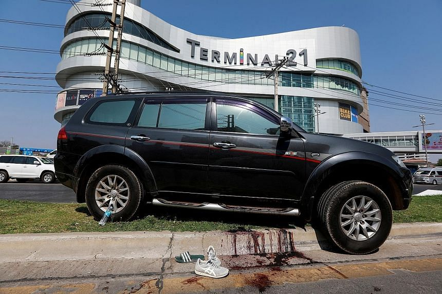 Above: At least 29 people were killed after a rogue soldier went on a shooting rampage at Terminal 21 mall in Nakhon Ratchasima, a four-hour drive from Bangkok. Below: A car belonging to a victim in front of the mall where the gunman staged a more th