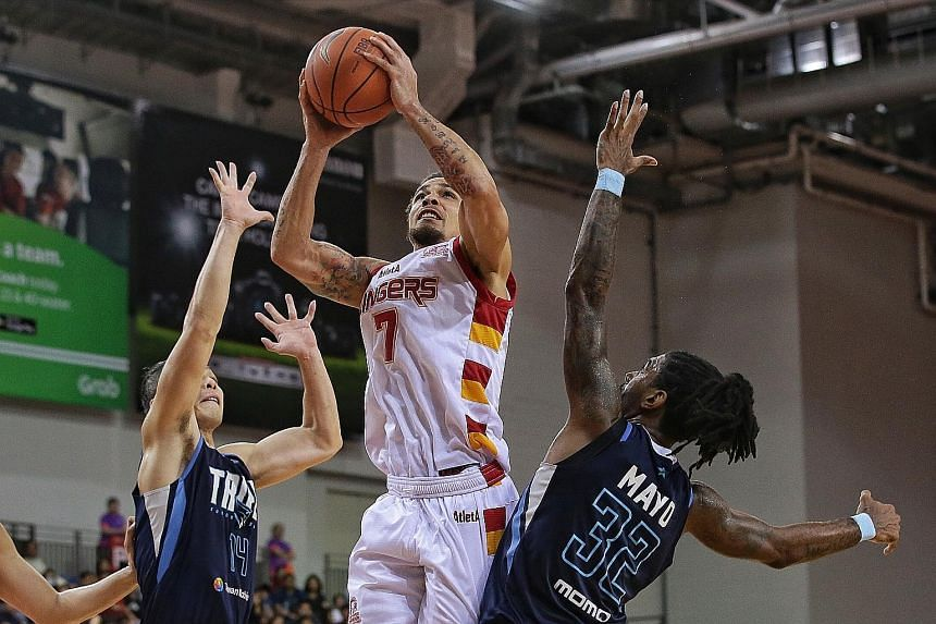 Singapore Slingers' Marcus Elliott scoring a basket during the Asean Basketball League match against Taipei Fubon Braves at the OCBC Arena yesterday. ST PHOTO: KEVIN LIM