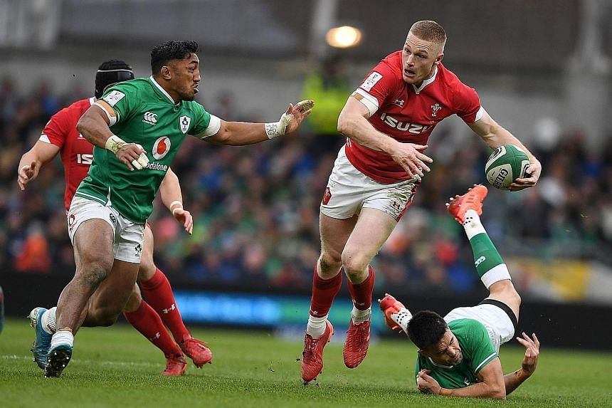 Irish players trying to stop Wales' prop Dillon Lewis during the Six Nations international rugby union match in Dublin on Saturday, which Ireland won 24-14. PHOTO: AGENCE FRANCE-PRESSE