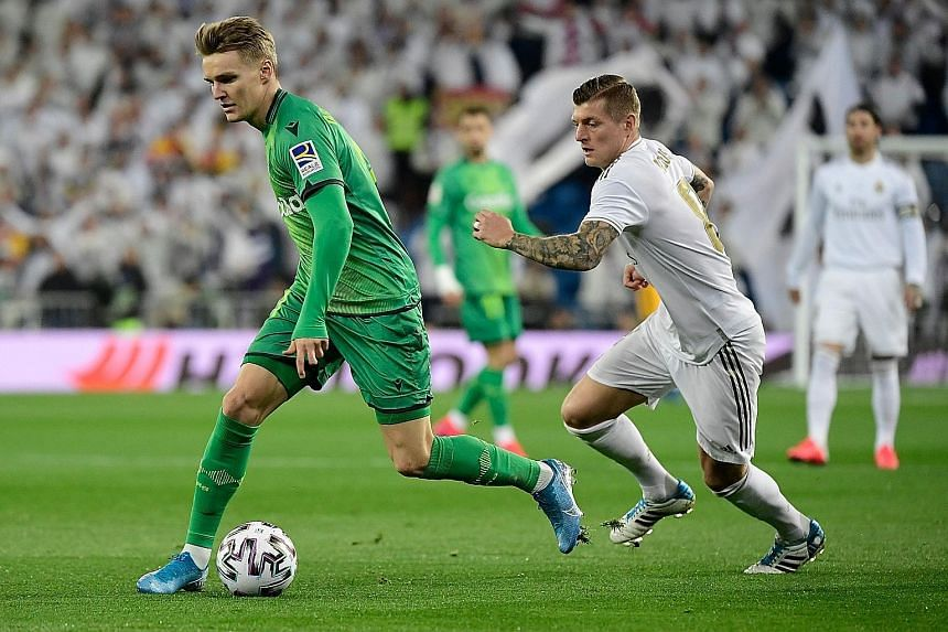 Real Sociedad midfielder Martin Odegaard (left, chased by Real Madrid's Toni Kroos) was among the scorers in his team's 4-3 King's Cup quarter-final win last week. PHOTO: AGENCE FRANCE-PRESSE