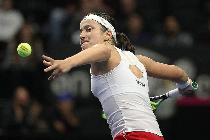 Latvia's Anastasija Sevastova (left) en route to beating Serena Williams (above) 7-6 (7/5) in the first set. While the American bounced back by winning the second set 6-3, she was outplayed on the big points in her 7-4 tiebreak loss in the decider. P