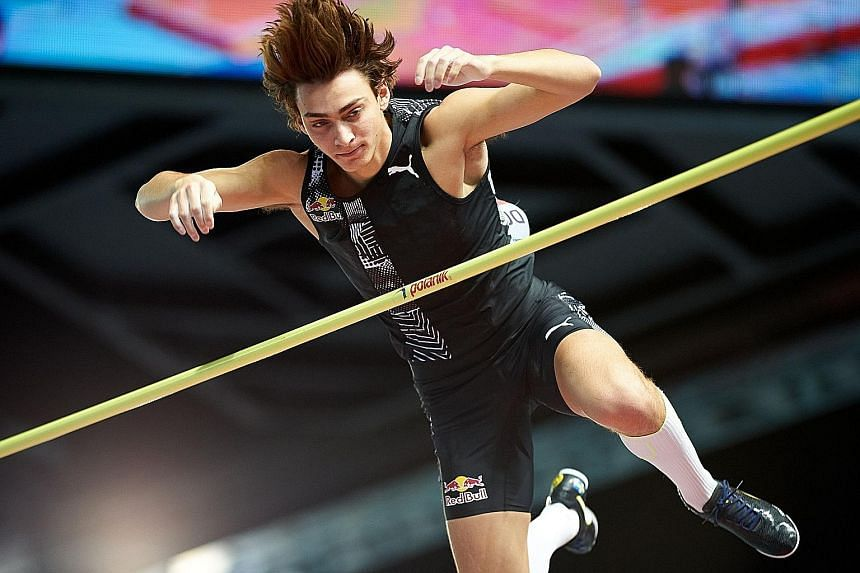 Sweden's Armand Duplantis clearing the bar at 6.17m for a world pole vault record on Saturday. He is expected to go even higher.