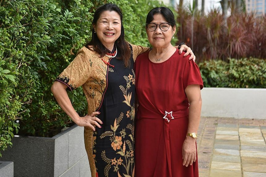 Madam Lim Sok Geok (left) with her helper Edencia Gamueda Antalan, who has worked for the family for 36 years. ST PHOTO: KELLY HUI