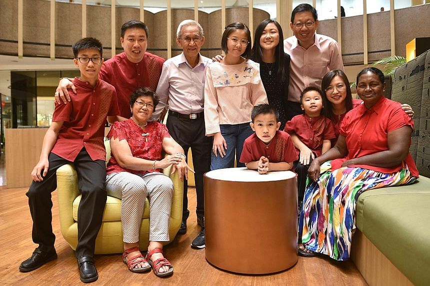 Ms Lam Chen Peng, touching Ms Panambarage Jacintha on the shoulder, and the rest of the Lam family: (From left, seated) Ms Lam's son Jonathan; her mother Mrs Lam; and her other two sons Edwin and Bryan. (From left, standing) Ms Lam's husband Roland T