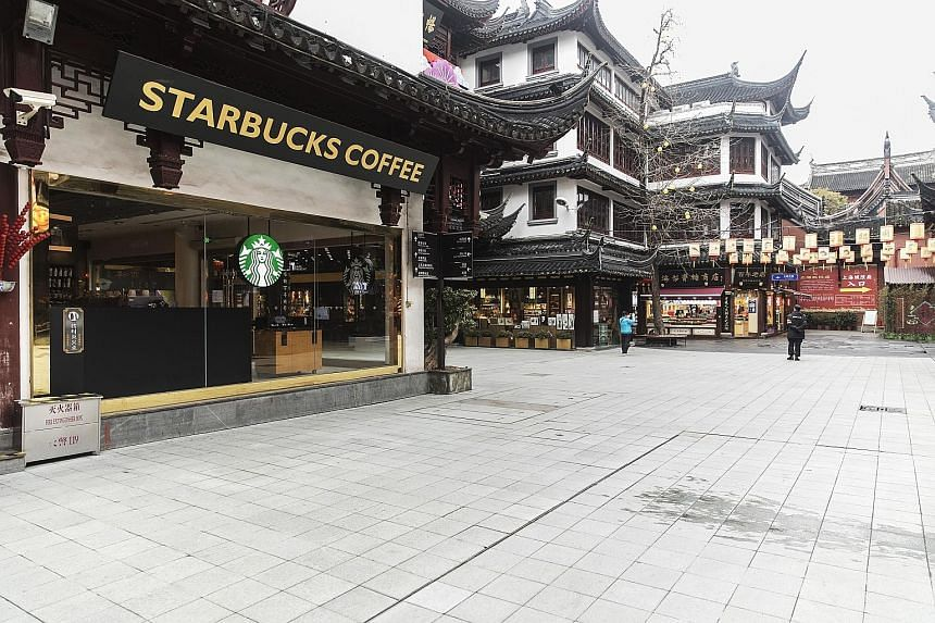 This Starbucks outlet in Shanghai was among those closed on Friday as part of efforts to control the outbreak. PHOTO: BLOOMBERG