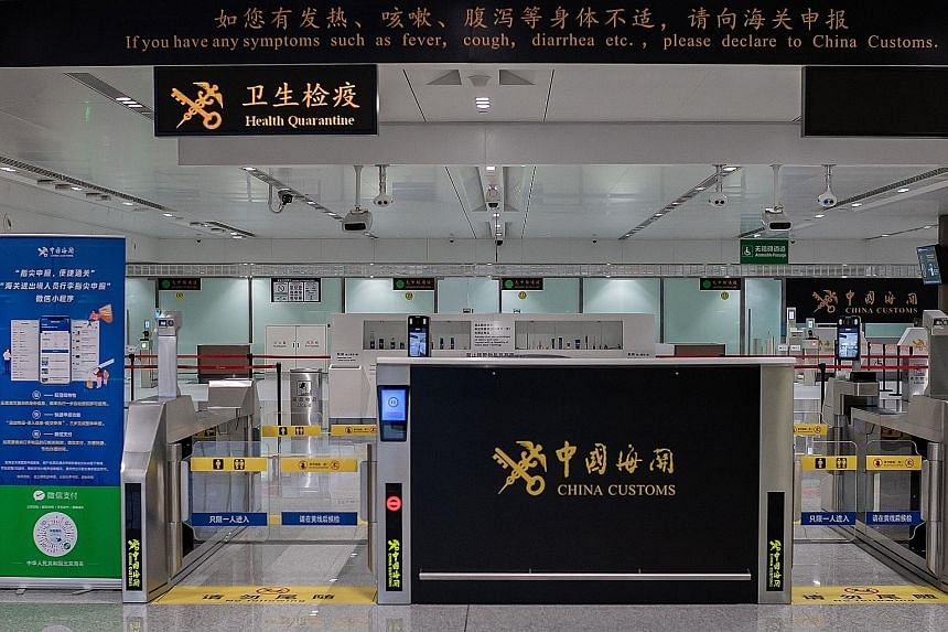A public health message at the Customs area of Beijing's Daxing International Airport. The coronavirus outbreak has not deterred some Singaporeans from returning to China, where they live and work.