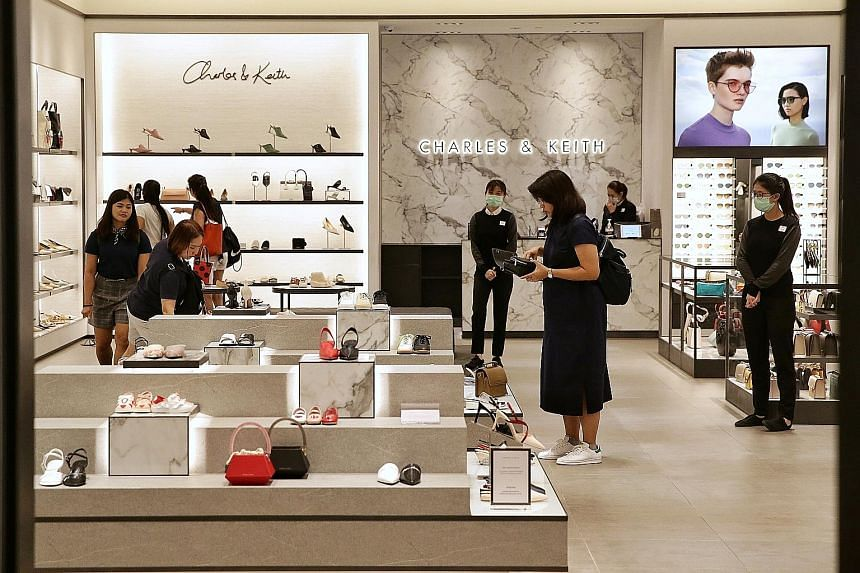 Shoppers browsing in Charles & Keith's Suntec City Mall outlet yesterday. The local fashion retailer, whose factories are mainly located in Guangdong in the south of China, said it has sufficient stock for now. ST PHOTO: KEVIN LIM