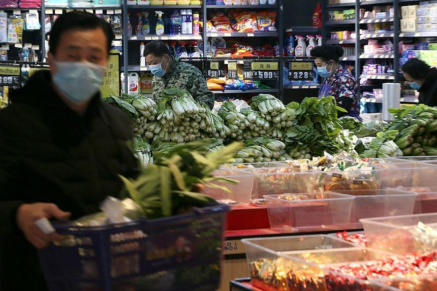 Shoppers at a food store in Wuhan, in China's Hubei province. Epidemiologist Ian Lipkin believes there is a chance that, by mass quarantining individuals, healthy patients could have come into contact with those who are infected but asymptomatic, whi