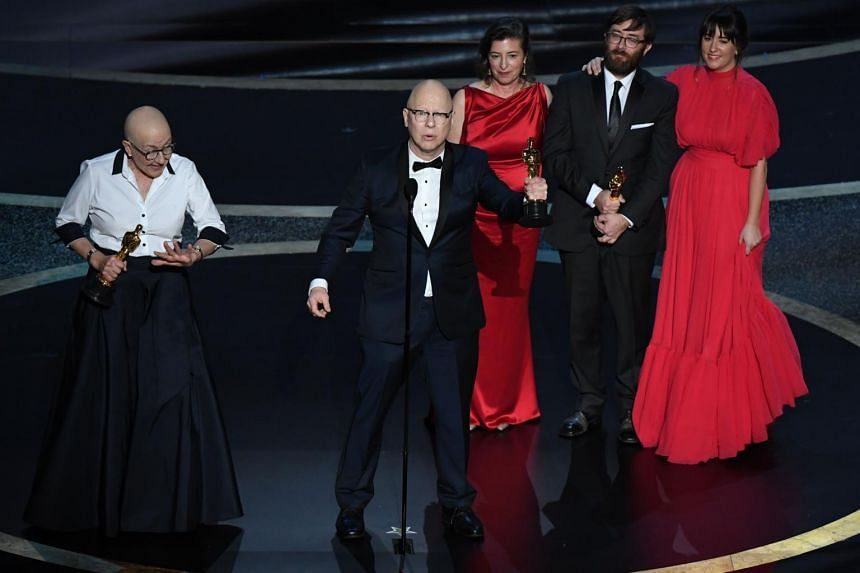 """Directors Steven Bognar (centre) and Julia Reichert accepts the award for Best Documentary Feature for """"American Factory"""" during the 92nd Oscars in Hollywood on Feb 9, 2020."""