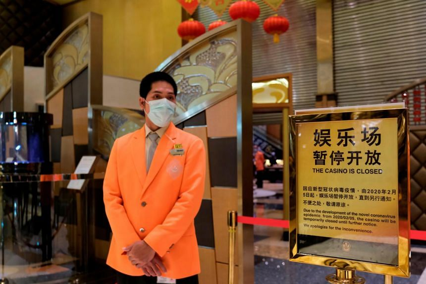 A security guard stands outside the closed Grand Lisboa casino, following the coronavirus outbreak in Macau on Feb 4, 2020.