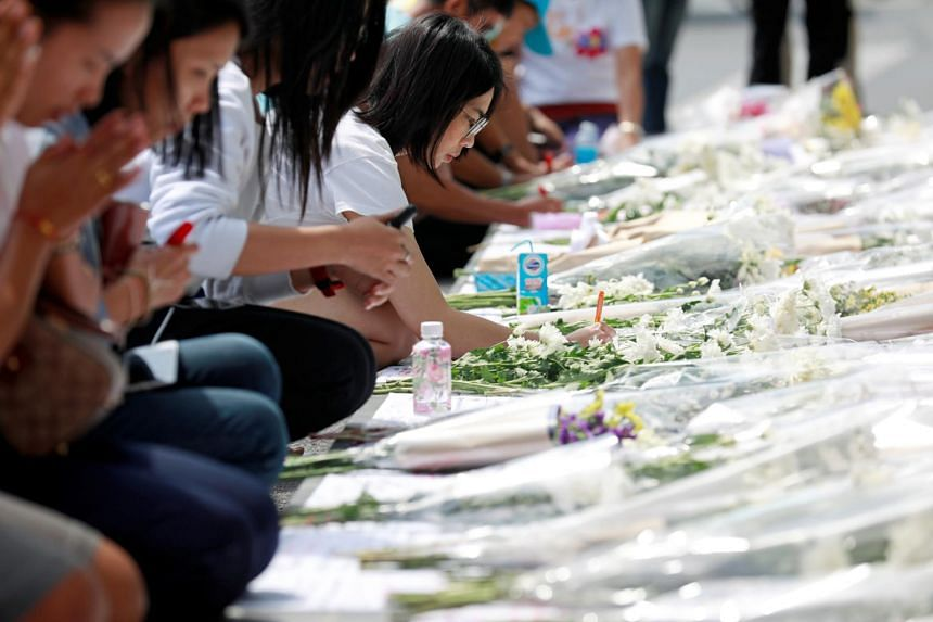 People leave flowers and messages at the Terminal 21 shopping mall after a shooting in Nakhon Ratchasima, Thailand, on Feb 10, 2020.
