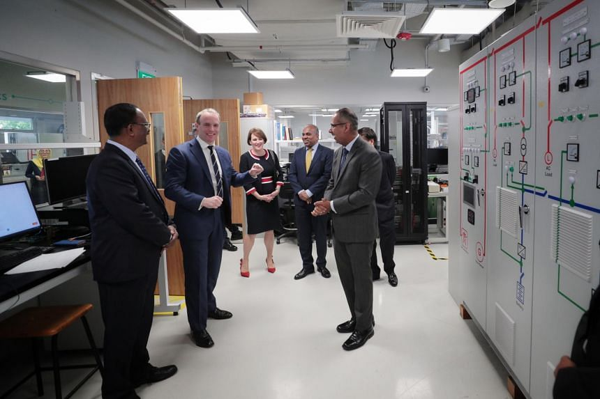Britain's Foreign Secretary Dominic Raab (second from left) visiting the Rolls-Royce@NTU Corporate Lab at the Nanyang Technological University on Feb 10, 2020.