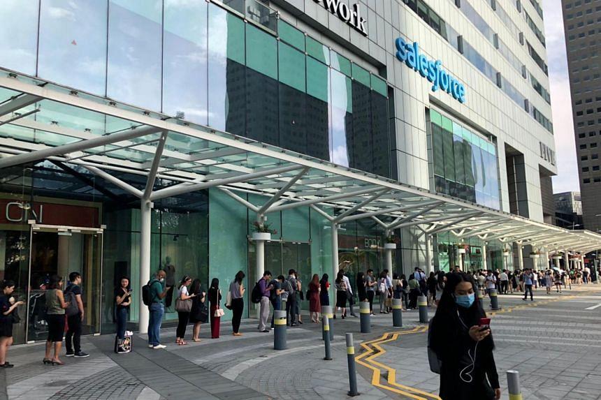 People queue for temperature screening at Suntec City on Feb 10, 2020.