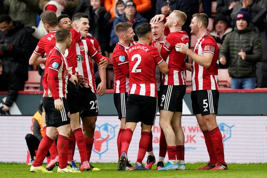 Sheffield United's John Lundstram celebrates scoring their second goal with teammates during the English Premier League football match against Bournemouth on Feb 9, 2020.