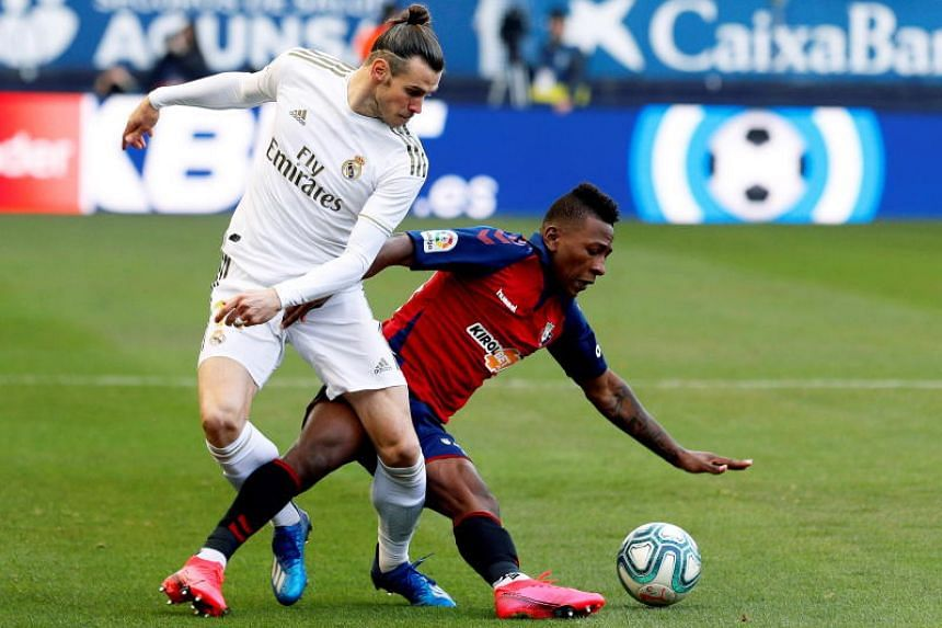Osasuna's Pervis Estupinan (right) in action against Real Madrid's Gareth Bale during the Spanish La Liga football match in Pamplona, northern Spain, on Feb 9, 2020.