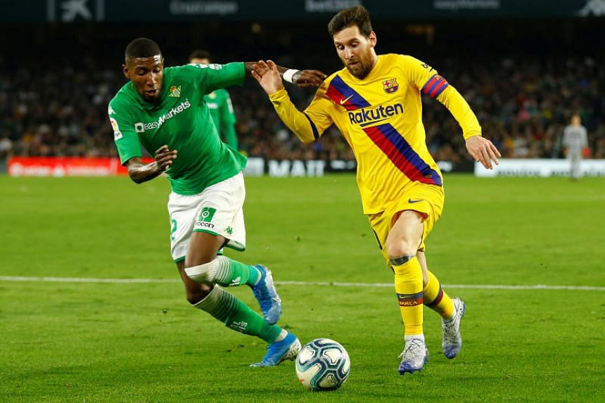 Barcelona's Lionel Messi in action with Real Betis' Emerson during the La Liga match in Seville, Spain, on Feb 9, 2020.