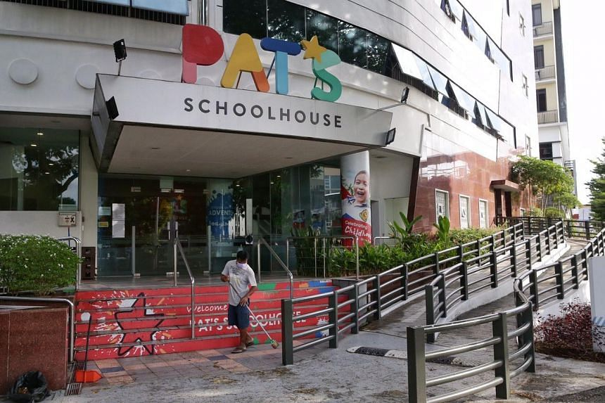 A worker of Pat's Schoolhouse Kovan sweeping the premises on Feb 10, 2020. A 71-year-old grandfather is among three new coronavirus cases confirmed in Singapore on Feb 9, and had picked up his grandchild outside the pre-school.