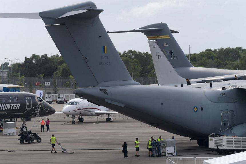 Participants and ground crews prepare for the static display of military aircraft during a media preview day ahead of the Singapore Airshow in Singapore, on Feb 9, 2020.