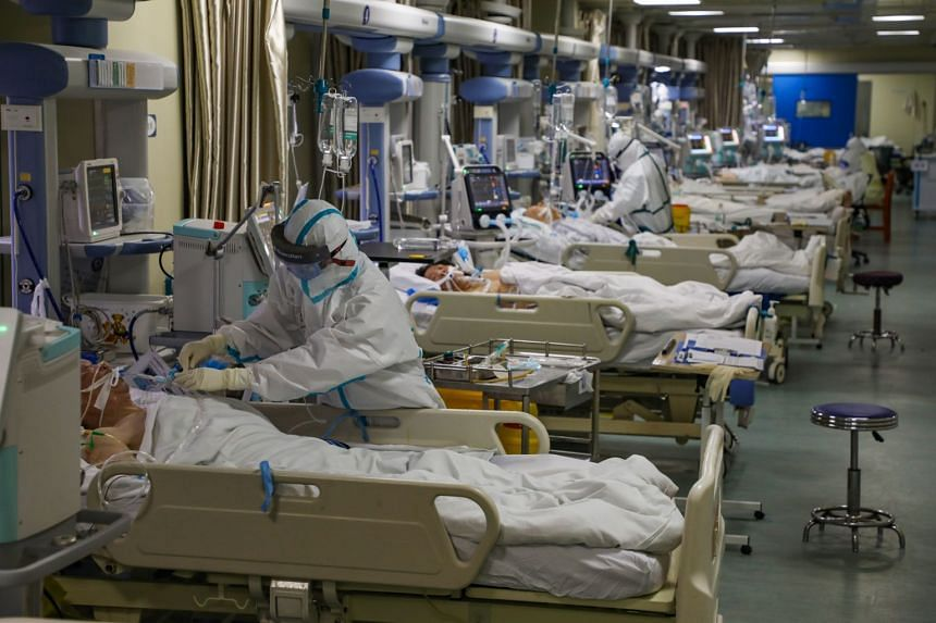 Medical staff work in the isolated intensive care unit in a hospital in Wuhan on Feb 6, 2020.
