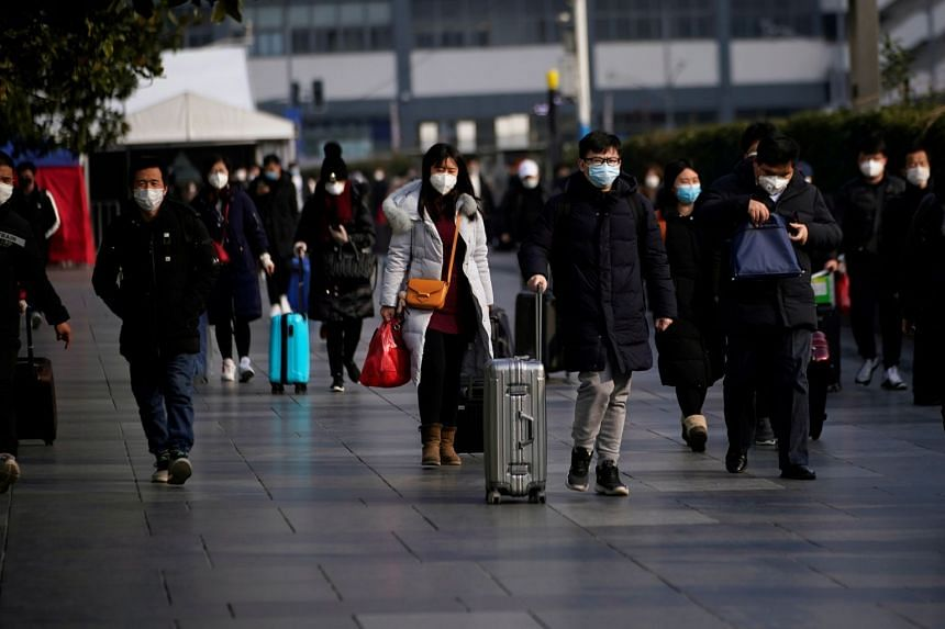 People with masks at the Shanghai railway station in China, on Feb 9, 2020