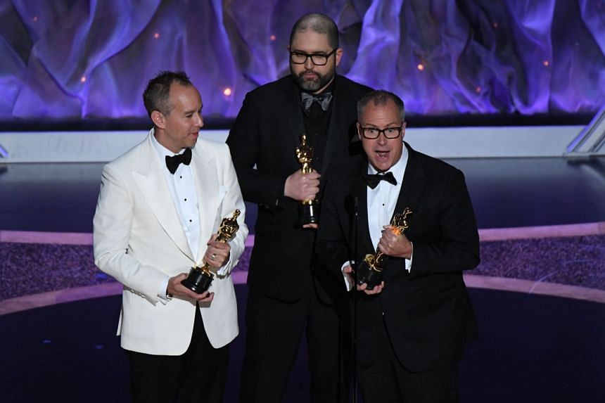 (From left) US producer Jonas Rivera, Josh Cooley and Mark Nielson accept the award for Best Animated Feature Film for Toy Story 4 during the Oscars at the Dolby Theatre in Hollywood on Feb 9, 2020.