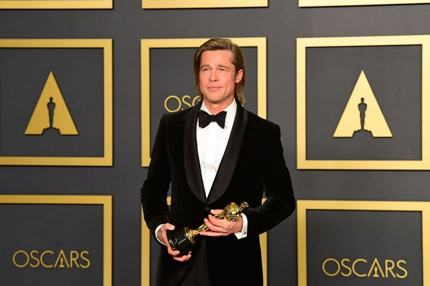 US actor Brad Pitt poses with the Oscar for Best Supporting Actor during the 92nd Oscars at the Dolby Theater in Hollywood, on Feb 9, 2020.