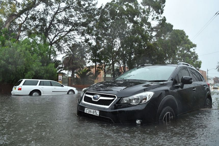 A car sits in floodwater in Sydney on Feb 9, 2020.