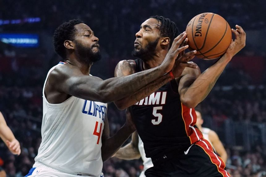 Miami Heat forward Derrick Jones Jr. (right) and LA Clippers forward JaMychal Green battle for the ball in the second quarter at Staples Center in Los Angeles, on Feb 5, 2020.