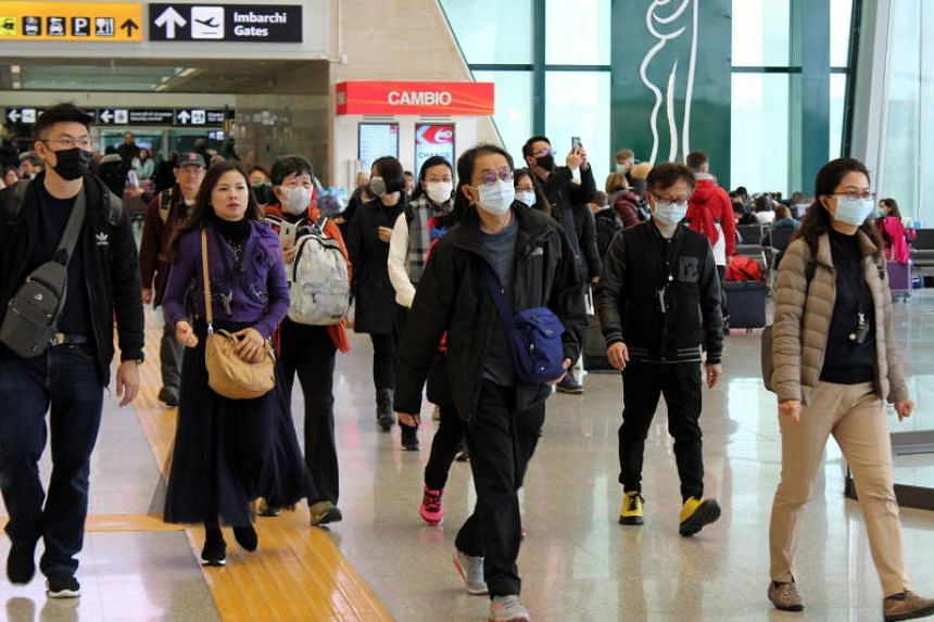 Travellers at Leonardo da Vinci Airport in Fiumicino, near Rome, on Jan 31, 2020. Italy has suspended flights to and from China, Hong Kong, Macau and Taiwan in a bid to prevent the spread of the deadly coronavirus.