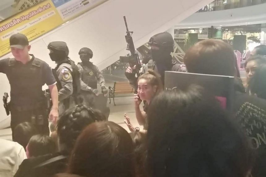 Security forces evacuting people from a shopping mall after a shooting rampage in Nakhon Ratchasima, Thailand, on Feb 8, 2020.