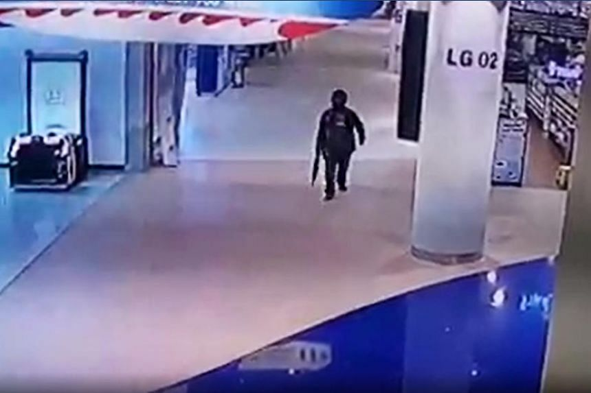 A screengrab from CCTV footage showing Thai soldier Jakrapanth Thomma walking through the Terminal 21 shopping mall in Nakhon Ratchasima on Feb 8, 2020.