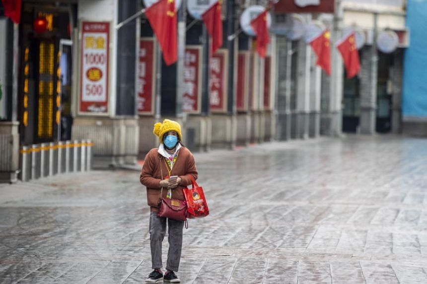 A woman walking in Guangzhou, in China's Guangdong province, on Feb 6, 2020. Guangdong is one of the 10 Chinese provinces the World Health Organisation is closely watching.
