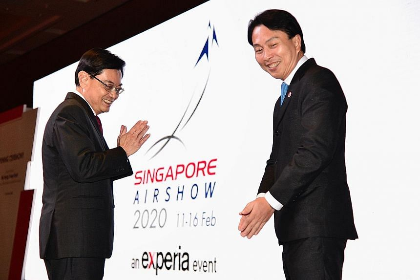 Left: Deputy Prime Minister Heng Swee Keat with Experia Events chairman Vincent Chong at the opening of this year's Singapore Airshow at Marina Bay Sands last night. In his opening speech, Mr Heng said that the virus outbreak has brought uncertainty