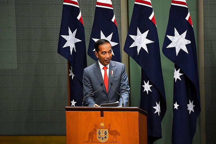 President Joko Widodo addressing the Australian Parliament yesterday, when he outlined a range of areas of potential collaboration with Australia. PHOTO: AGENCE FRANCE-PRESSE