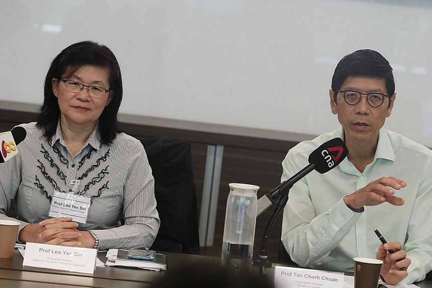 Professor Leo Yee Sin (left), executive director of the National Centre for Infectious Diseases, and Professor Tan Chorh Chuan, chief health scientist at the Ministry of Health, at a press conference yesterday. ST PHOTO: KELVIN CHNG