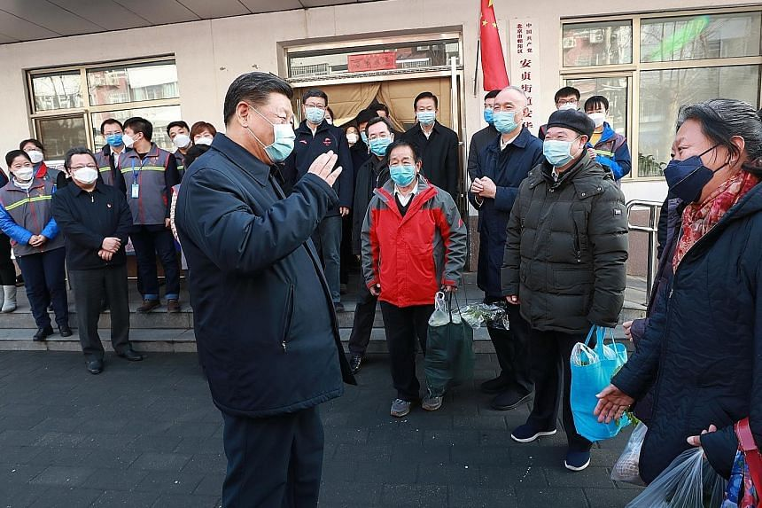 """Chinese President Xi Jinping, with a face mask, visiting the centre for disease control and prevention in Beijing's Chaoyang district. He vowed to win the battle against the coronavirus with """"more decisive measures""""."""